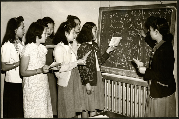 Mrs. James Lee teaching war brides English, 1948. San Francisco History Center, San Francisco Public Library.